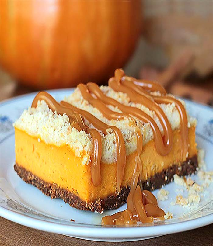 These pumpkin cheesecake bars are the PERFECT fall dessert. From their crunchy ginger cookie crust,  creamy pumpkin cheesecake filling, to the buttery streusel, the textures and flavors are simply divine.