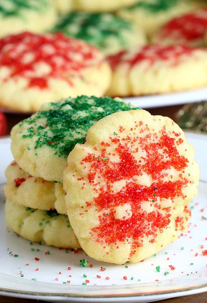 Santa will be begging you for more if you leave these Christmas Sugar Cookies out for him to nibble on this Christmas!