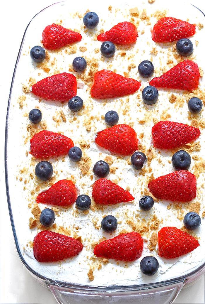 Summer Berry Cheesecake Poke Cake is a perfect red, white, and blue dessert for your Memorial Day, 4th of July BBQ's or any family get-together…
