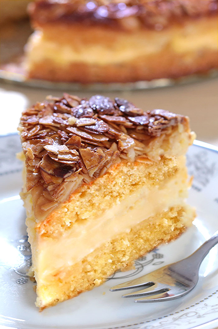 Bee Sting Cake - Crunchy, honey-flavored almond topping, creamy filling, and two delicious yeast cake layers make this traditional German dessert absolutely wunderbar!