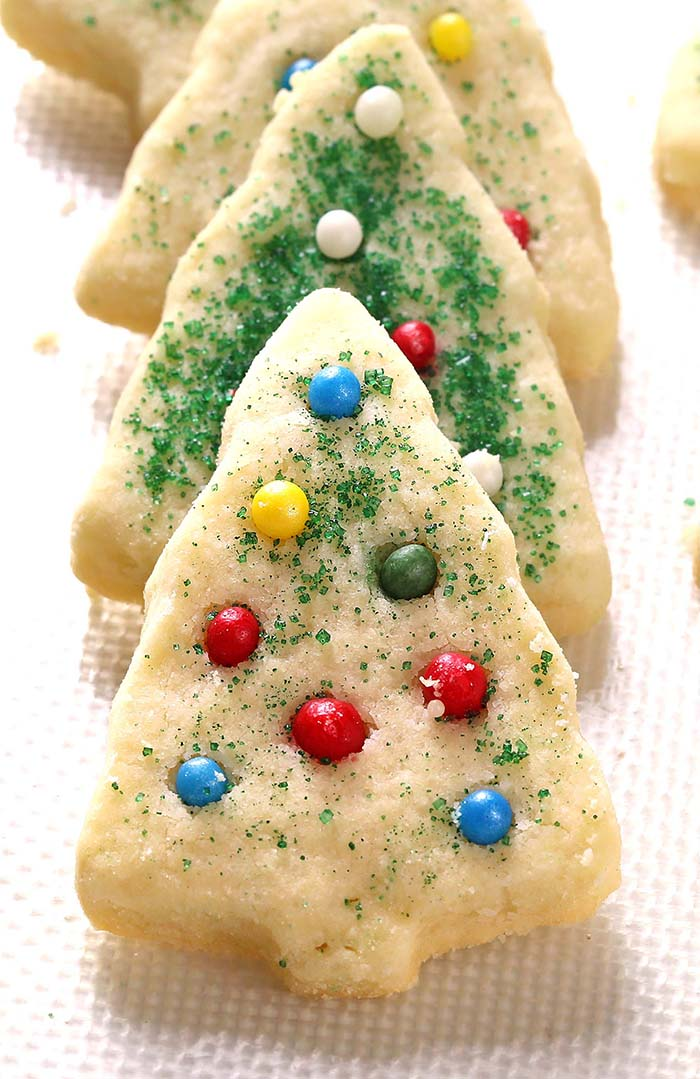 These delicious, buttery and melt in your mouth Christmas Shortbread Cookies look like they came from a fine bakeshop! Perfect for gifting and parties, people of all ages love them!