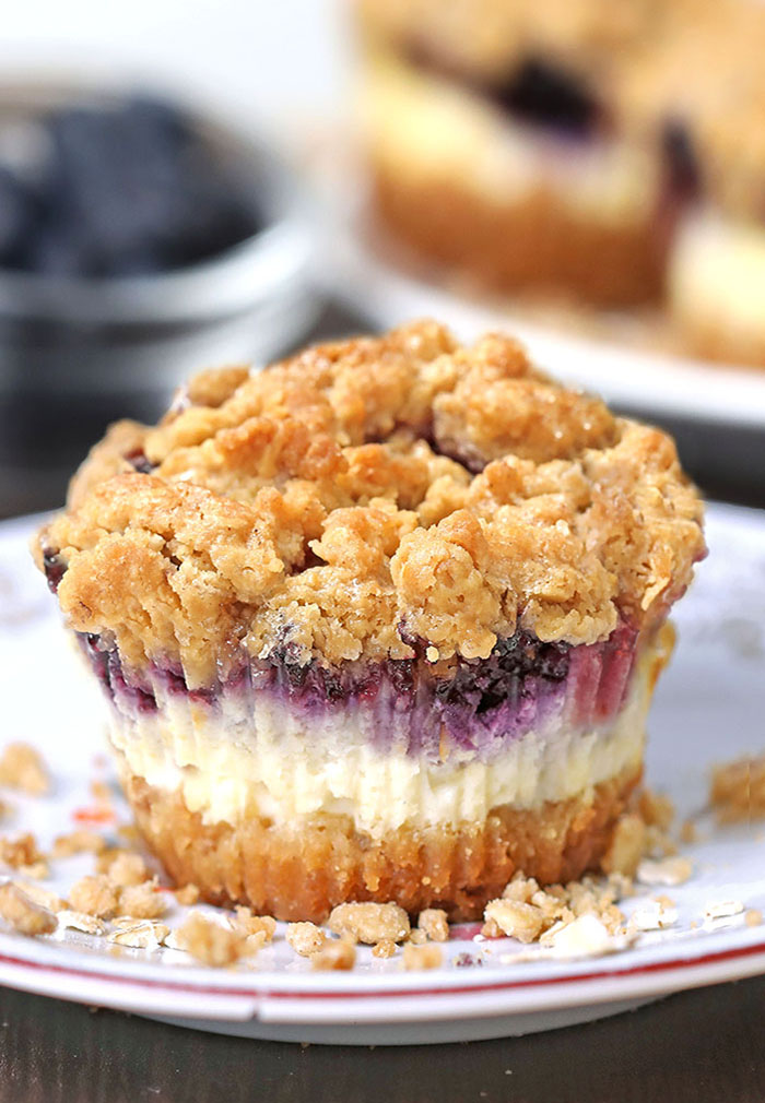Blueberry Crumble Mini Cheesecakes are delicious just like your favorite blueberry crumble, baked on graham cracker crust and packed into perfect portable cheesecake dessert.
