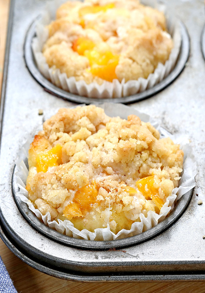 Easy Peach Cobbler Muffins are delicious just like Grandma's peach cobbler, with a perfect streusel topping and cinnamon flavor.