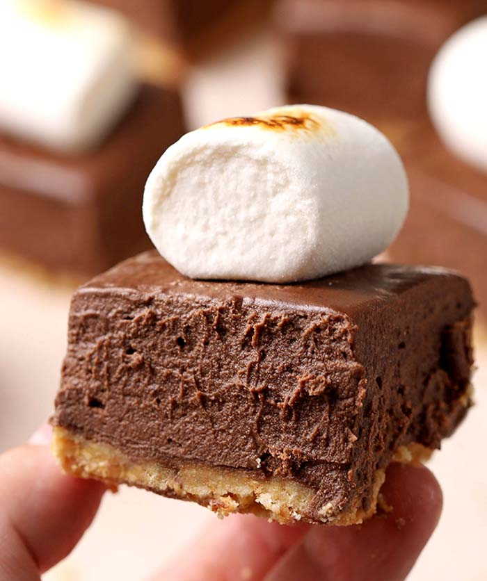 These Hot Chocolate Pie Bars are too good to be true. Decadent dessert made with graham crackers crust, luscious chocolate filling and toasted marshmallows.
